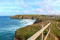 A landscape view of Mawgan Porth from the South West Coast Path, North Cornwall along the Atlantic coast near Newquay.