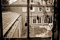 Breda, Netherlands. View from a 2nd floor bedroom window of a former monastery and hospital building, into a former monastery garden. Shot on analog f...