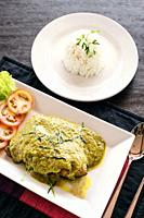 thai fish fillet with asian green curry sauce meal and rice.