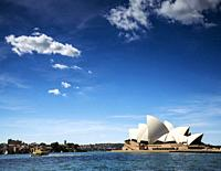 famous sydney landmark opera house view with ferry boat in australia on sunny day.