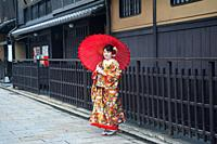 25. 12. 2017, Kyoto, Japan, Asia - A young woman wearing a traditional kimono poses for a portrait in the old city of Kyoto.