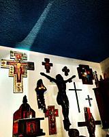 A ray of light illuminates a cross in a home in Leon, Guanajuato, Mexico