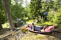 Young man in hammock, Stockholm archipelago