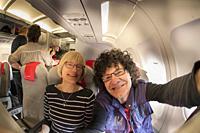 Selfie of a couple onboard plane