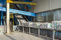 Machinery processing crushed plastic bottles at recycling sorting facility, Roche, Vaud Canton, Switzerland.