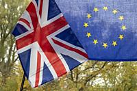 UK flag and EU flag, juxtaposed as a symbol for BREXIT negotiations in autumn environment.