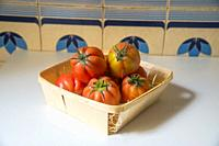 Raf tomatoes in a basket. Still life.