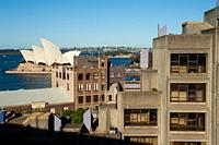 Sydney, New South Wales, Australia - An elevated view from Sydney Harbour Bridge of buildings in the urban locality of The Rocks and the Sydney Opera ...