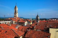 View of the roofs of houses and the tower of the Palazzo Civico. Ivrea. Italy.