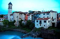 Neighborhood bihind the Vecchio bridge and its houses on the bancks of the Dora Baltea river. Ivrea. Italy.