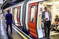United Kingdom Great Britain England, London, Embankment Underground Station, subway tube, public transportation, platform, man, passenger, commuter, ...
