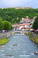 Bistrica river with stone bridge and fortress dominating Prizren, Kosovo.