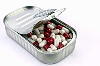 Can full of white and red capsules, conceptual image.