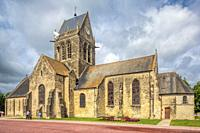 Church of Sainte-Mère-Église, Normandy, with the Parachute Memorial on the bell tower. The town played a significant part in the World War II Normandy...