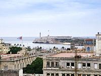 View of the lighthouse (faro) of Castillio del Morro from the old town of Havana, Cuba.