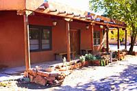 Old adobe Pueblo style house in Los Carrillos, NM.