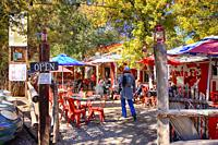 People enjoying the fall colors and temps whilst eating outside at the Hollar Restaurant in Madrid, New Mexico.