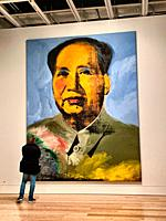 Man Admiring Andy Warhol´s Chairman Mao Painting. New York, NY, USA