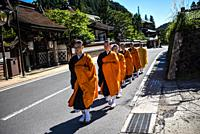 Group of female monks walking in the streets of Koyasan or Mount Koya, a huge temple settlement in Wakayama Prefecture.