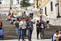 Asian tourists taking a selfie at the Spanish Steps in Rome,Italy