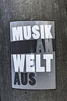 """sticker saying: """"""""musik an, welt aus"""""""", """"""""music on, world off"""""""", stuttgart, baden-wuerttemberg, germany."""