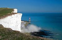 Cliff fall creating dust cloud at Beachy Head Lighthouse, Eastbourne, East Sussex, England, Uk.