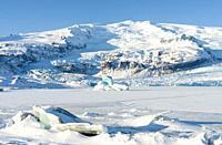 Glacier Fjallsjoekull and frozen glacial lake Fjallsarlon in Vatnajokull NP during winter. Europe, Northern Europe, Iceland, February.