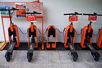 Singapore, Republic of Singapore, Asia - Neuron E-scooters are being charged at a charging point in the city centre. They can be rented for a fee usin...