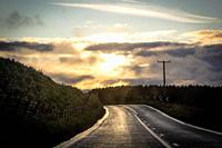 Scottish landscape on the road at the sunset.