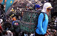 Jakarta, Java, Indonesia, Asia - Indonesian garbage collectors are searching for recyclable materials like plastic and metal at the Bantar Gebang garb...