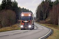 Salo, Finland - November 16, 2018: Next Generation Scania S730 of Heikkila for chemical transport on the road in autumn with high beams on briefly. .
