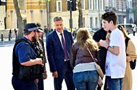 Andy Bell - Political Editor, Channel 5 News - outside Downing Street, 2018. Talking to police and a family after a young girl was knocked over by his...