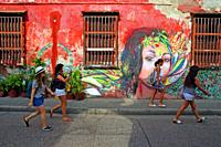graffiti and young people in the street, Getsemaní district, Cartagena de Indias, Colombia