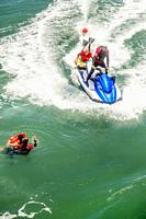 A rescue water craft arrives for a drowning victim and a lifeguard in Huntington Beach, CA.