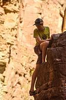 Dylan Wu practising his climbing skills Matkatamiba Canyon, Grand Canyon National Park, Arizona, USA.