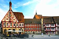 Half-timbered buildings at Rathausplatz - Town hall square, on left - Rathaus - Town Hall, in background St. Martin church, historic part of Forchheim...