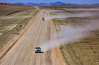 Namibian desert Four wheel drive vehicles on the gravel roads of western Namibia.