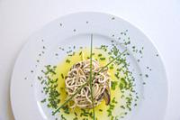 Gulas with mushrooms, spring onion, parsley and olive oil. Spain.