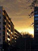 Winter sunset light over buildings at Les Corts district, Barcelona city. Barcelona province, Catalonia, Spain.