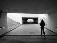 Young woman at railroad underground pathway. Mataro city. Maresme region, Barcelona province, Catalonia, Spain.