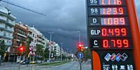 Fuel station signpost. Stormy afternoon at Esplugues de Llobregat city. Barcelona Metropolitan Area, Catalonia, Spain.