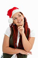 Young modern girl wearing Santa Claus hat isolated on white background.