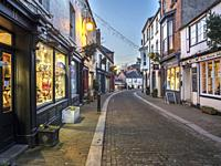 Christmas lights across Kirkgate in Ripon at dusk North Yorkshire England.