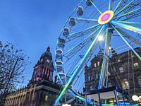 Leeds Wheel of Light illuminated at dusk at Christmas on The Headrow in Leeds West Yorkshire England.