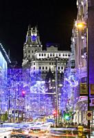 Christmas lights at Gran Via street with Telefonica building at the background. Madrid. Spain.