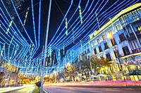 Christmas lights at Alcal‡ street with Cibeles square at the background. Madrid. Spain.