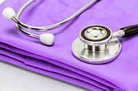 Stethoscope on clothes of nurse, conceptual image.