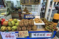 Singapore, Singapore - October 18, 2018: Food stall selling tropical fruits such as Durian in China Town.