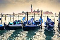 Gondolas and San Giorgio Maggiore Island. . St Mark´s Square. Venice, Italy. Europe.