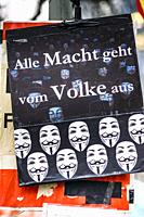 """poster showing various guy-fawkwes-masks and a text that reads: """"all power derives from the people"""", franfurt/main, hesse, germany."""